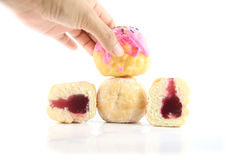 Are hand picked donuts. Royalty Free Stock Images