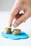 Hand picking gold coin Stock Photography