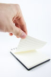 Hand picking notepad, notebook paper Stock Image