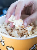 Hand picking popcorn Stock Image