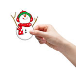 Hand picking snowman Stock Photo