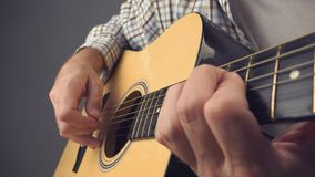 Hand picking strings on acoustic guitar stock video