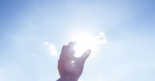 Hand picking sun at blue sky and cloud Royalty Free Stock Photography