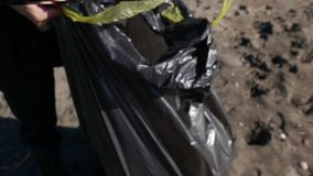 Land cleaning trash on the beach stock video footage