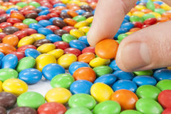 Hand picking up Chocolate Candy Royalty Free Stock Photo