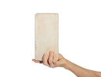 Hand picking up white brick Stock Photography