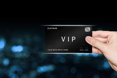Hand picking VIP or very important person platinum card Royalty Free Stock Image
