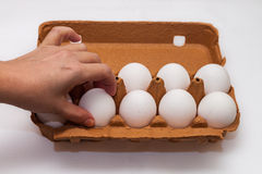 A hand picks an egg out Royalty Free Stock Images