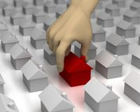 Hand Picks a House. 3D image of a hand picking a red house from amongst many others Royalty Free Stock Image