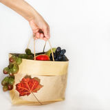 Hand picks package with fresh fruit Royalty Free Stock Photo