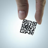 Hand picks Qr code. Close up of hand picks Qr code as concept Stock Image