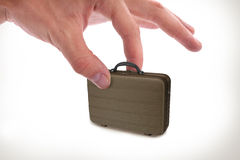 Hand pickup suitcase Royalty Free Stock Photography