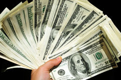 Hand with pile of money Royalty Free Stock Photos