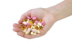 Hand with pill Royalty Free Stock Photos