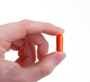 Hand and pill Royalty Free Stock Photography