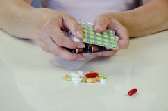 Hand with pill blister. Human hand holding blisters of colorful medicals Stock Photography