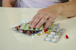 Hand with pill blister. Human hand holding blisters of colorful medicals Royalty Free Stock Photo