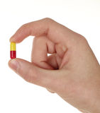 Pill on hand Stock Images