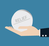 Hand with pill of relief Royalty Free Stock Photos