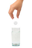 Hand, pill and water glass Stock Image
