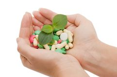 Hand with a pill on white Royalty Free Stock Images
