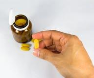 hand pillen Fotografering för Bildbyråer