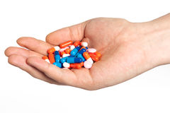 Hand with pills Stock Image
