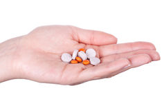 Hand with pills Stock Photos
