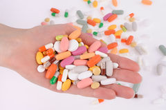 Hand with a pills Royalty Free Stock Image