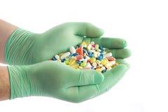 Hand with pills. Stock Photos