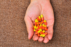 Hand with pills Stock Photography