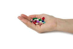 Hand with pills Stock Images