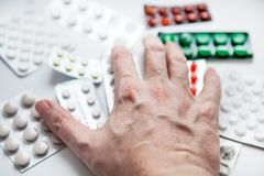 Hand with a Pills Stock Image