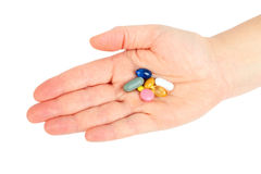 Hand with pills. On white background Royalty Free Stock Photo