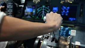 Hand of pilot push thrust lever handle for engine control takeoff stock video footage