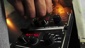 Hand of pilot selecting radio frequency, turning control on panel during flight. Stock footage stock footage