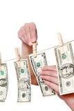 Hand pinch money on clothes line isolated Stock Photography