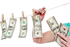Hand pinch money on clothes line isolated Stock Photo