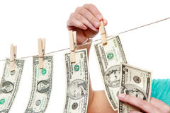 Hand pinch money on clothes line isolated Royalty Free Stock Image