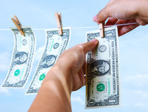 Hand pinch money on clothes line. Pinching money on clothes line in monetary concept stock photography