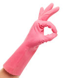 Hand in a pink domestic glove shows ok Royalty Free Stock Photos
