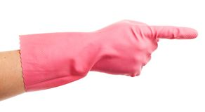 Hand in a pink domestic glove shows Royalty Free Stock Photos
