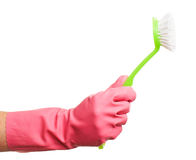 Hand in a pink glove holding brush Royalty Free Stock Image