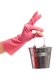 Hand in a pink glove holding silver pail Stock Photography