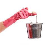 Hand in a pink glove holding silver pail Stock Photo