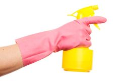 Hand in a pink glove holding spray bottle Stock Photo