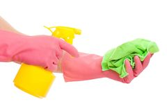 Hand in a pink glove holding spray and sponge Stock Photos