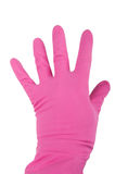 Hand in a pink rubber glove Stock Images