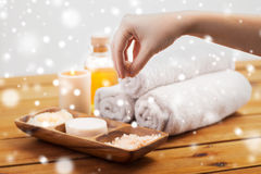 Hand with pink salt and bath stuff Stock Images