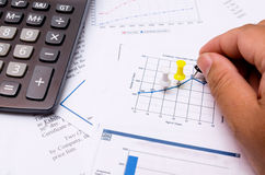Hand pinning on the graph Stock Photography